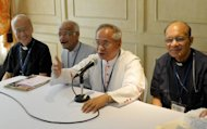 Filipino Archbishop Orlando Quevedo (2-R) speaks during a press briefing in Manila on August 15, 2009. Church leaders in the Philippines said Saturday that an impending birth control law aimed at reducing poverty in the conservative nation was one step towards legalising abortion