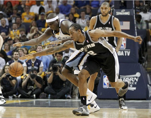 Spurs' Leonard steals the ball from Grizzlies' Randolph during the second quarter in Game 3 of their NBA Western Conference final playoff basketball series in Memphis