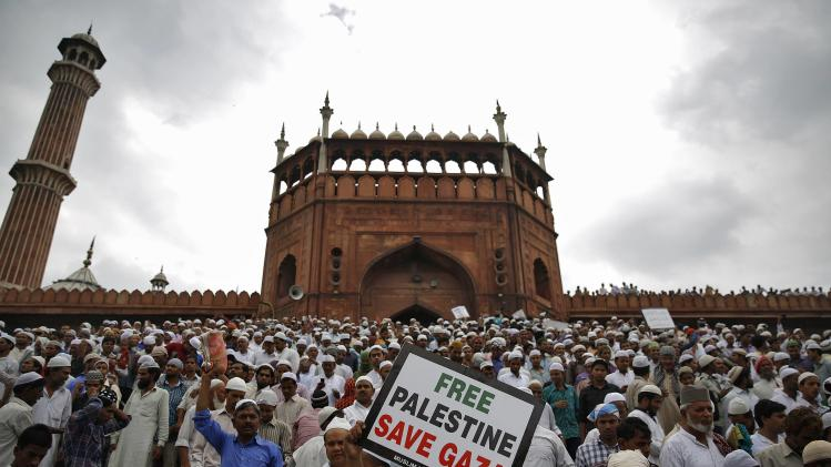 Demonstrators take part in a protest against Israel's military action in Gaza, after offering last Friday prayers of the holy fasting month of Ramadan at the Jama Masjid in Delhi