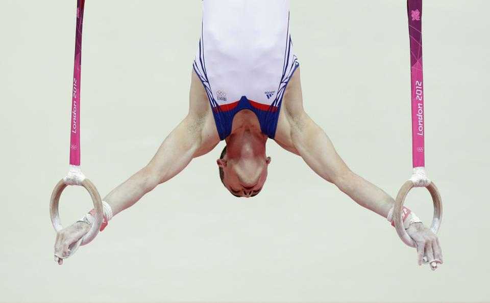 Gymnast Cyril Tommasone from France performs on the rings during the Artistic Gymnastics men's qualification at the 2012 Summer Olympics, Saturday, July 28, 2012, in London. (AP Photo/Julie Jacobson)