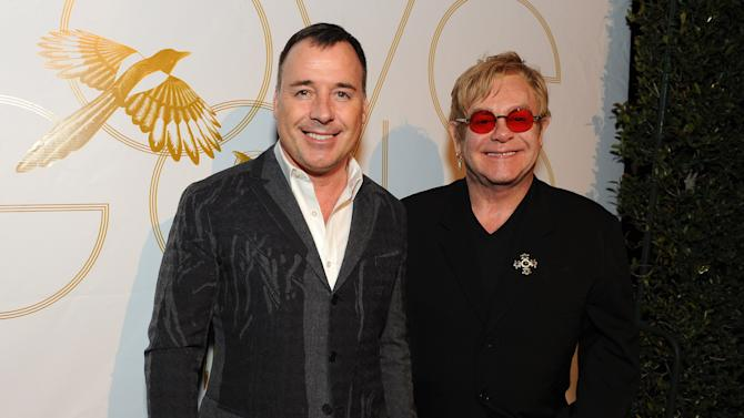 """David Furnish and Elton John attend LoveGold/EJAF Celebrate """"How to Survive a Plague"""" at Chateau Marmont on February 22, 2013 in Los Angeles. (Photo by Jordan Strauss/Invision for LoveGold/AP Images)"""