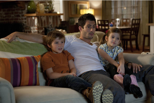 Tyler Champagne as Travis Molly, Brian Hallisay as Kyle Parks and Cassidy Guetersloh as Katy Parks in &quot;The Client List.&quot; 