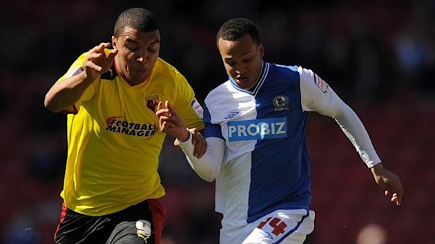 Troy Deeney, left, scored twice against struggling Blackburn