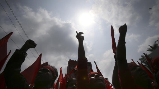 Protesters shout slogans during a May Day rally on Wednesday May 1, 2013 in Dhaka, Bangladesh. Thousands of workers paraded through central Dhaka on May Day to demand safer working conditions and the death penalty for the owner of a building housing garment factories that collapsed last week in the country's worst industrial disaster, killing at least 402 people and injuring 2,500. (AP Photo/Wong Maye-E)