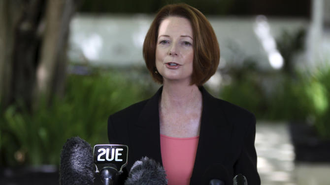 FILE - In this Nov. 9, 2012 photo, Australian Prime Minister Julia Gillard talks to media in Bali, Indonesia. Gillard surprised Australians on Wednesday, Jan. 30, 2013 by announcing that elections will be held Sept. 14, in a country where governments have traditionally given the opposition little more than a month's notice to keep a strategic advantage. (AP Photo/Firdia Lisnawati, File)