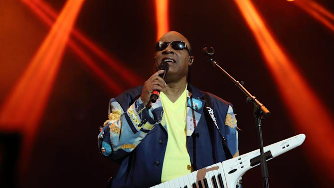 """FILE - In this May 19, 2013 file photo, Stevie Wonder performs at The Hangout Festival in Gulf Shores, Alabama. Wonder plans to release two albums next year, including some newly written songs, and is working on a third. The 63-year-old performer said in an interview Tuesday, Oct. 29, 2013, that his first albums in eight years would be """"When the World Began"""" and """"Ten Billion Hearts."""" (Photo by John Davisson/Invision/AP, File)"""