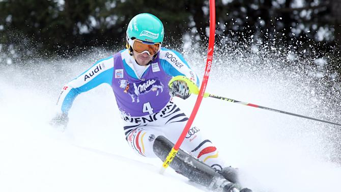 Germany's Felix Neureuther speeds past a pole on his way to clock the second fastest time in the first run of an Alpine ski World Cup men's slalom, in Wengen, Switzerland, Sunday, Jan. 20, 2013. (AP Photo/Alessandro Trovati)