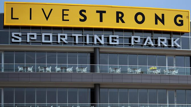 FILE - In this June 7, 2011, file photo, signs and balconies overlook the main entrance of Livestrong Sporting Park, home of the Sporting Kansas City MLS soccer club, in Kansas City, Kan. Lance Armstrong's reputation may be in tatters after his announcement on Thursday, Aug. 23, 2012, that he would no longer fight the doping allegations that have dogged him for years, but in the eyes of corporate and individual donors, his charity still wears an unsullied yellow jersey. The club, which has promised to donate $7.5 million in stadium revenues to Armstrong's foundation over six years, says it will not consider renaming the venue. (AP Photo/Orlin Wagner, File)