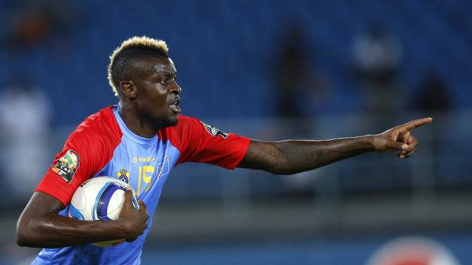 Democratic Republic of Congo's Jeremy Bokila celebrates after scoring against Tunisia during their Group B soccer match of the 2015 African Cup of Nations in Bata