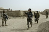 <p>US soldiers conduct a joint patrol with members of the Afghan National Army September 5, 2012 in Kandahar province. NATO aims to train 350,000 Afghan soldiers and police by the end of 2014 as it transfers all security responsibilities to President Hamid Karzai's local forces.</p>