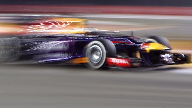 Red Bull Formula One driver Sebastian Vettel of Germany drives during the second practice session of the Singapore F1 Grand Prix at the Marina Bay street circuit in Singapore September 20, 2013. (Reuters)