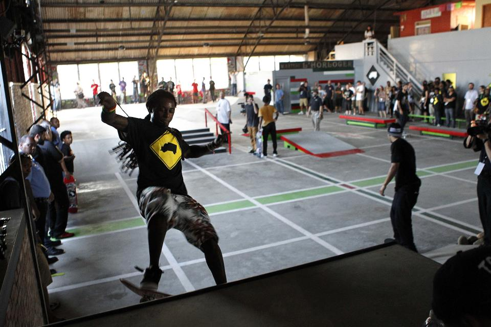 Recording artist Lil Wayne skates in a new skateboard park he helped finance along with Glu Agency and Mountain Dew, in the Lower Ninth Ward of New Orleans, Wednesday, Sept. 26, 2012. (AP Photo/Gerald Herbert)