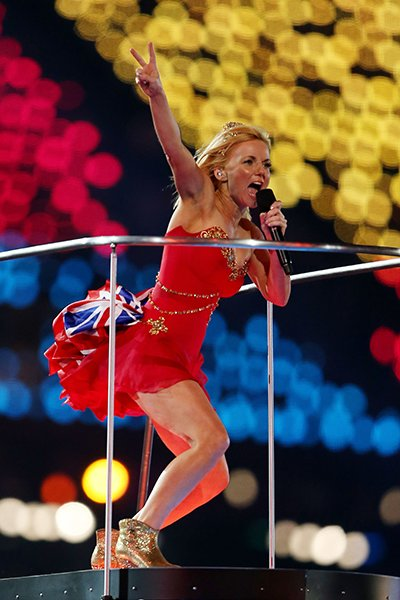 Ginger Spice -- AKA Geri Halliwell -- revealed her trademark Union Jack by adding it to the bustle of her cheeky little red Suzanne Neville dress. Isabel Marant ankle boots and a tiara rounded out the
