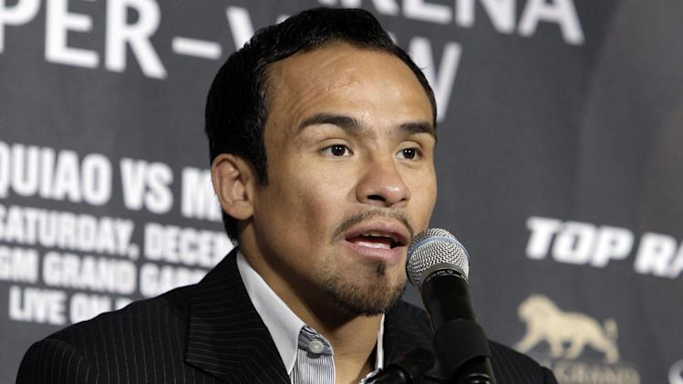 Juan Manuel Marquez, of Mexico, speaks during a news conference in Beverly Hills, Calif., Monday, Sept. 17, 2012, to promote his upcoming boxing match with Manny Pacquiao. The two will fight for the fourth time on Dec. 8 in Las Vegas. (AP Photo/Reed Saxon)