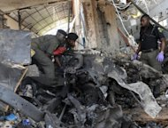 Police work at the site of a bombing in Abuja, Nigeria, on April 26. A blast went off outside a nightclub in the Nigerian capital late Friday, June 22, hours after the national security adviser and defence minister were sacked amid fears over spiralling violence in the country&#39;s north