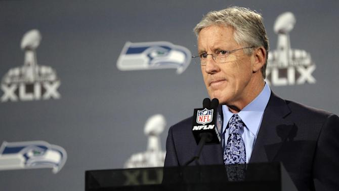 Seattle Seahawks head coach Pete Carroll answers a question at a news