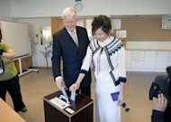 Icelandic President Olafur Ragnar Grimsson (L) and his wife Dorrit Moussaieff cast their votes in presidential elections in Reykjavik. Grimsson is set for a record fifth term in office after facing down a challenge from a well-known television reporter who had a new baby on the campaign trail