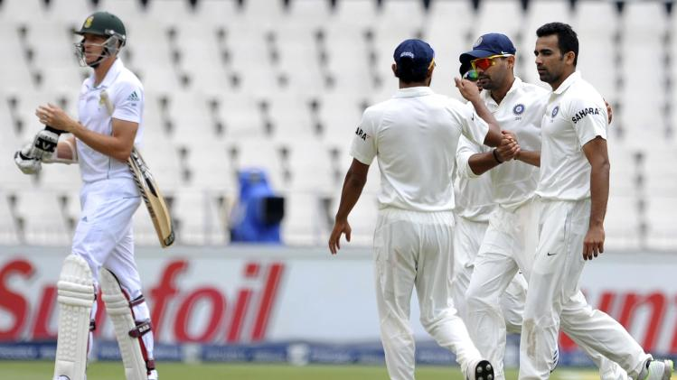 India's players celebrate the dismissal of South Africa's Morne Morkel after he was bowled out by India's Zaheer Khan during the third day of their cricket test match in Johannesburg