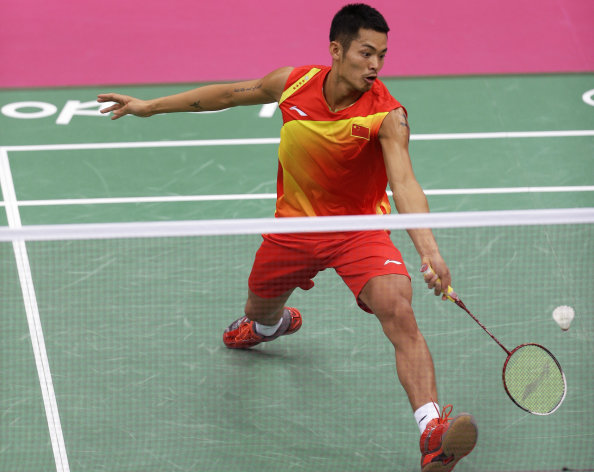 China's Lin Dan plays against Ireland's Scott Evans in a men's singles badminton match at the 2012 Summer Olympics, Monday, July 30, 2012, in London. (AP Photo/Andres Leighton)