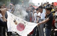 &lt;p&gt;Chinese protesters burn a Japanese flag in Luoyang, as they protest against Japan&#39;s &quot;nationalizing&quot; of the disputed Diaoyu Islands -- also known as Senkaku Islands in Japan. Angry demonstrators attempted to storm the Japanese embassy in Beijing, state media said, as tens of thousands of people across China protested against Japan over a growing territorial dispute.&lt;/p&gt;