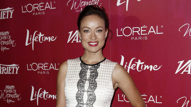 Actress Olivia Wilde arrives at Variety's 3rd Annual Power of Women Luncheon in Beverly Hills, Calif., Friday, Sept. 23, 2011. The luncheon celebrates the philanthropic and charitable contributions of women in entertainment. (AP Photo/Matt Sayles)