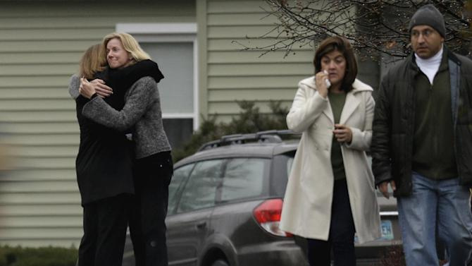 Mourners arrive for the funeral service of Sandy Hook Elementary School shooting victim, Jack Pinto, 6, Monday, Dec. 17, 2012, in Newtown, Conn. Pinto was killed when a gunman walked into Sandy Hook Elementary School in Newtown Friday and opened fire, killing 26 people, including 20 children.(AP Photo/David Goldman)