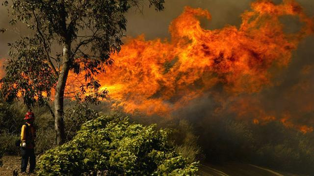 Calif. wildfires race toward communities