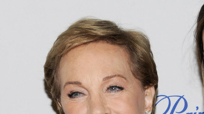 """FILE - This Nov. 1, 2011 file photo shows Julie Andrews at the Princess Grace Foundation Awards gala in New York. The Oscar and Tony Award-winning actress said that a botched operation to remove non-cancerous throat nodules in 1997 hasn't gotten better. It has permanently limited her range and her ability to hold notes. """"The operation that I had left me without a voice and without a certain piece of my vocal chords,"""" said Andrews, who starred in such quintessential stage and film musicals as """"The Sound of Music,"""" """"My Fair Lady"""" and """"Mary Poppins."""" (AP Photo/Evan Agostini, file)"""