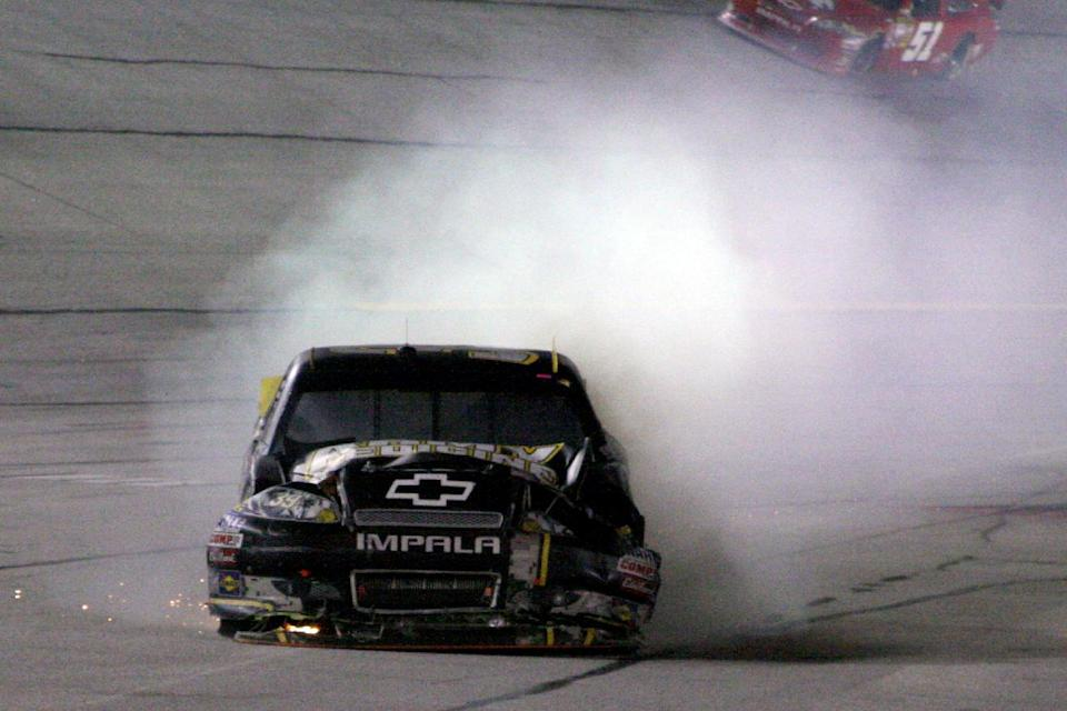 Ryan Newman (39) brings his car into the pits after it caught fire during the NASCAR Sprint Cup Series auto race at Atlanta Motor Speedway, Sunday, Sept. 2, 2012, in Hampton, Ga. (AP Photo/Dale Davis)