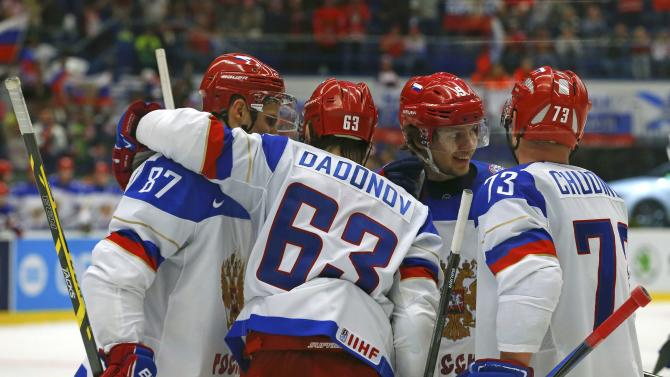 Russia's Dadonov celebrates his goal against Slovenia with team mates during their Ice Hockey World Championship game at the CEZ arena in Ostrava