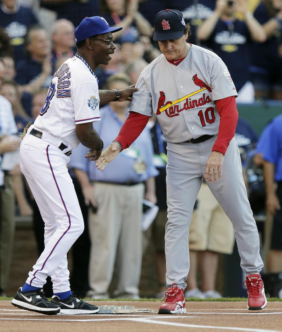 American League manager Ron Washington, left, of the Texas Rangers, and National League manager Tony La Russa shake hands before the start of the MLB All-Star baseball game, Tuesday, July 10, 2012, in Kansas City, Mo. (AP Photo/Charlie Riedel)