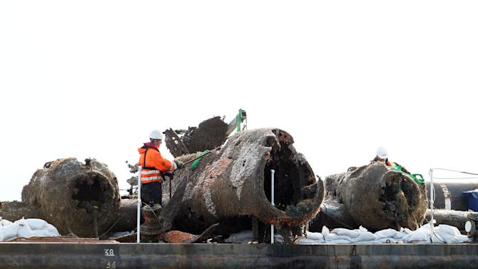 The remains of a crashed World War II Dornier bomber, the only surviving German Second World War Dornier Do 17 bomber, rests on a barge after being raised from the English Channel off Deal, southern England, Monday June 10, 2013. The aircraft was shot down off the Kent coast more than 70 years ago during the Battle of Britain and the project is believed to be the biggest recovery of its kind in British waters. Attempts by the RAF Museum to raise the relic over the last few weeks have been hit by strong winds but the operation was finally successful. (AP Photo/PA, Gareth Fuller) UNITED KINGDOM OUT NO SALES NO ARCHIVE