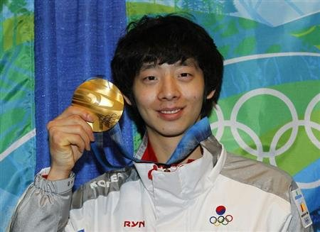 Lee of South Korea poses with his gold medal at the medal ceremony for the men's 1500 metres short track speed skating competition during the Vancouver 2010 Winter Olympics