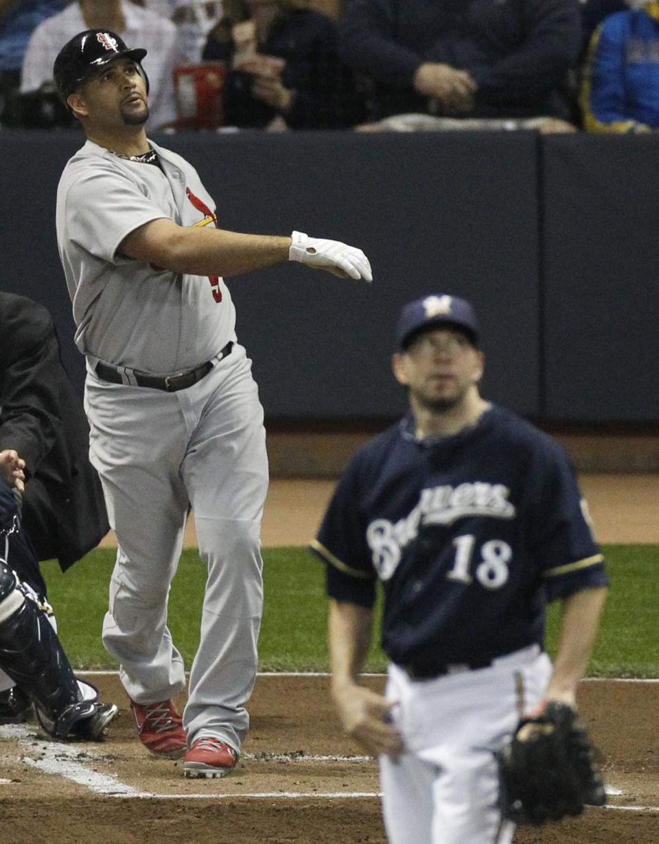 St. Louis Cardinals' Albert Pujols (5) and Milwaukee Brewers starting pitcher Shaun Marcum (18) watch Pujols' two-run home run during the first inning of Game 2 of baseball's National League championship series Monday, Oct. 10, 2011, in Milwaukee. (AP Photo/Jeff Roberson)