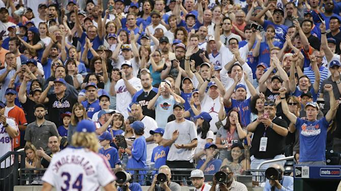 New York Mets fans cheer for starting pitcher Noah Syndergaard (34) as he leaves the field after being ejected from the game during the third inning of a baseball game against the Los Angeles Dodgers, Saturday, May 28, 2016, in New York. (AP Photo/Frank Franklin II)