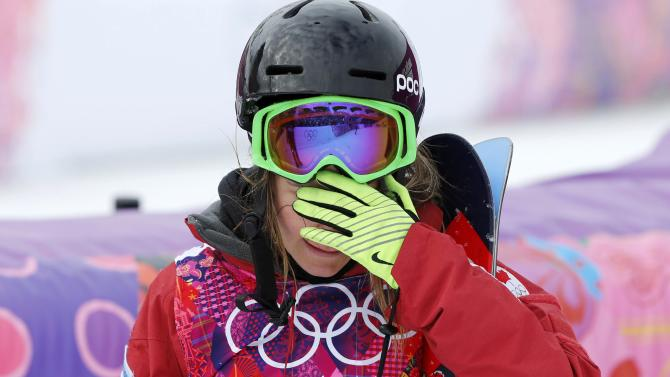 Canada's Kaya Turski reacts after crashing during women's freestyle skiing slopestyle qualification event at 2014 Sochi Winter Olympic Games in Rosa Khutor