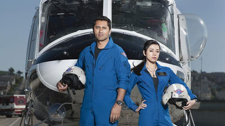 "Cliff Curtis as ""Rabbit"" and Aimee Garcia as Marisa in the NBC series Trauma."