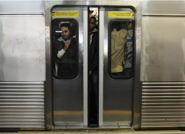 Commuters ride a subway train during rush hour in downtown Sao Paulo