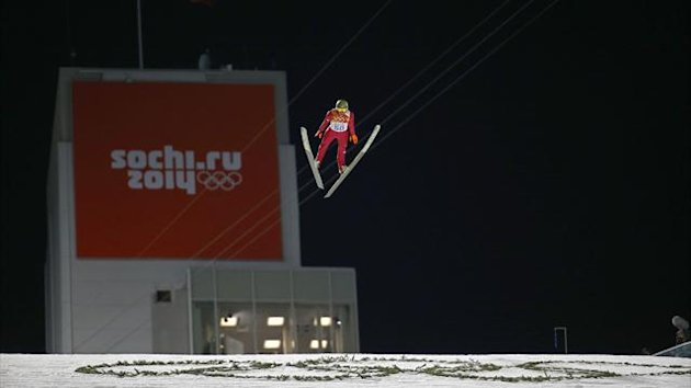 Poland's Kamil Stoch soars through the air during the first round of the men's ski jumping large hill individual final (Reuters)
