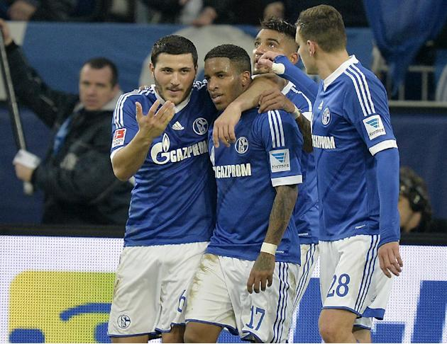 Schalke's Jefferson Farfan, 2nd from left,  is celebrated by teammates after scoring a penalty during the German Bundesliga soccer match between FC Schalke 04 and SC Freiburg in Gelsenkirchen, Ger