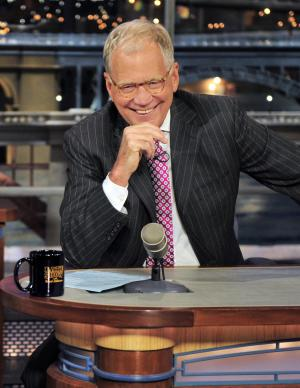 """FILE - In this April 23, 2012 file photo provided by CBS, host David Letterman appears during a taping of his show """"Late Show with David Letterman, in New York. Letterman says he plans to retire next year as host of """"Late Show."""" During a taping of his show Thursday, April 3, 2014, Letterman said he has informed his CBS bosses that he will step down in 2015, when his current contract expires. He told his audience he expects his departure will be """"at least a year or so"""" from now. (AP Photo/CBS, John Paul Filo) MANDATORY CREDIT; NO ARCHIVE; NO SALES; NORTH AMERICAN USE ONLY"""