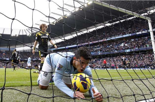 Manchester City's Aguero celebrates a goal scored by Toure during their English Premier League soccer match against Chelsea at The Etihad Stadium in Manchester