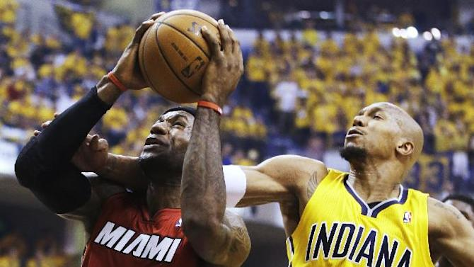 Indiana Pacers forward David West (21) tries to stop a shot by Miami Heat forward LeBron James (6) during the first half of Game 1 of the Eastern Conference finals NBA basketball playoff series Sunday, May 18, 2014, in Indianapolis