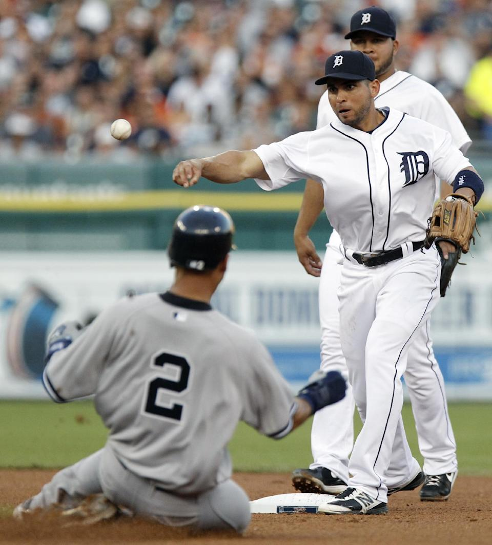Detroit Tigers second baseman Omar Infante, with shortstop Jhonny Peralta, rear, watching, throws to first after forcing out New York Yankees' Derek Jeter (2) in the fourth inning of a baseball game Tuesday, Aug. 7, 2012, in Detroit. Robinson Cano was out at first base. (AP Photo/Duane Burleson)