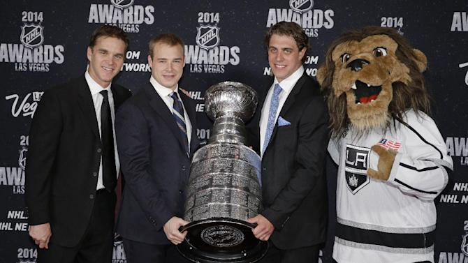From left, Luc Robitaille, Dustin Brown, and Anze Kopitar and the mascot of the Los Angeles Kings pose with the Stanley Cup on the red carpet before the NHL Awards on Tuesday, June 24, 2014, in Las Vegas