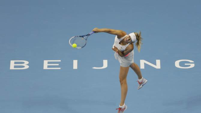 Maria Sharapova of Russia serves during her women's singles tennis match at the China Open tennis tournament in Beijing