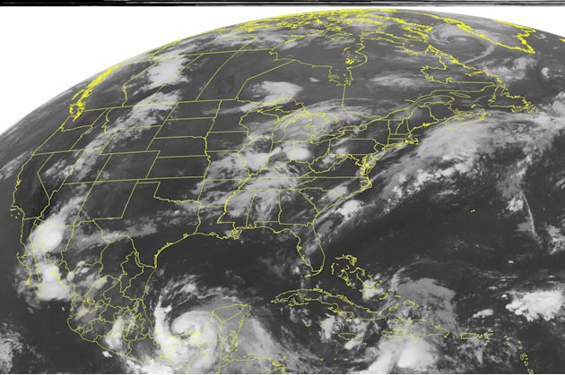 This NOAA satellite image taken Thursday, Aug. 9, 2012 at 1:45 a.m. EDT shows Tropical Storm Ernesto strengthens as it continues spinning over the extreme southern Bay of Campeche.  This system has ma