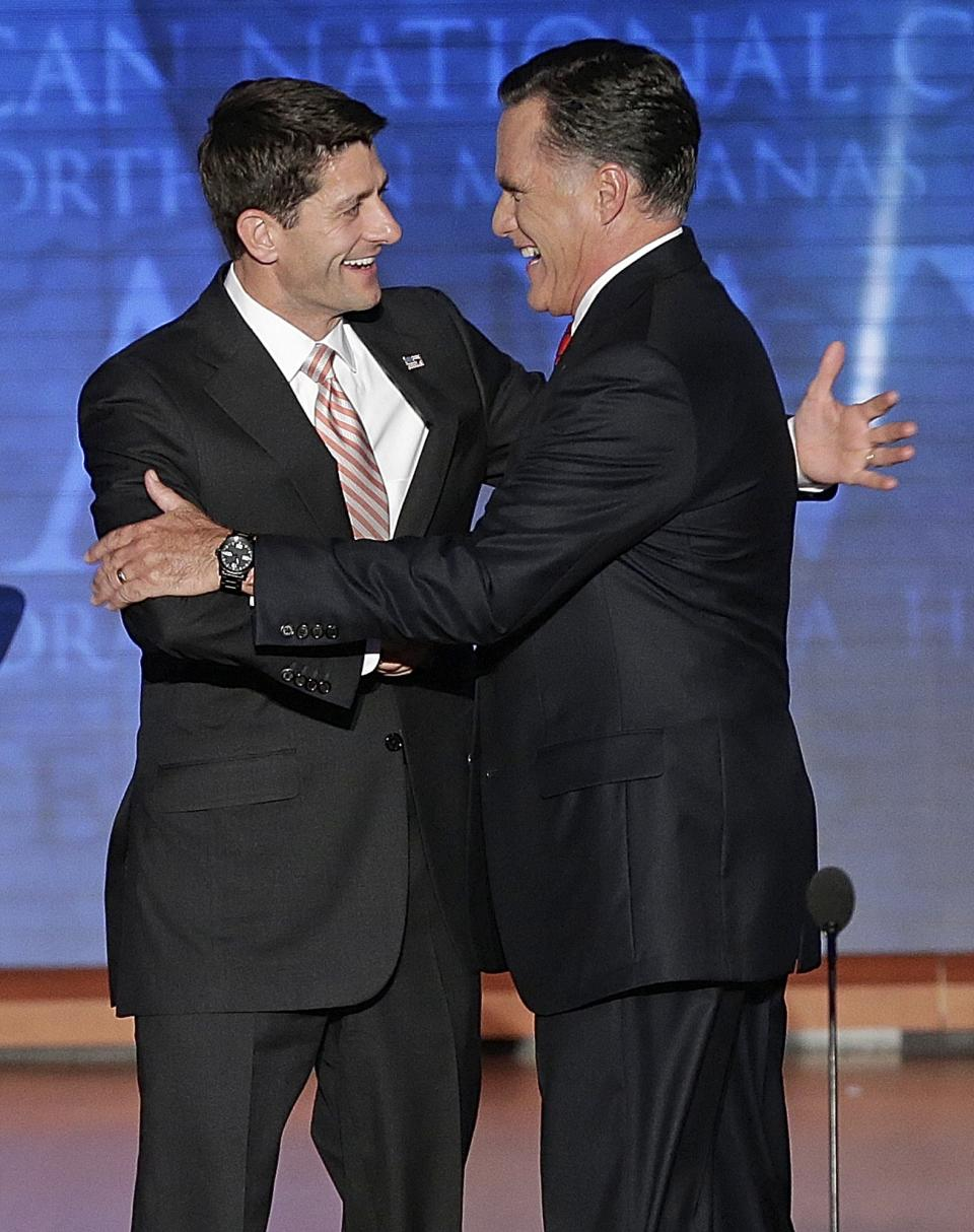 Republican vice presidential nominee, Rep. Paul Ryan greets presidential nominee Mitt Romney during the Republican National Convention in Tampa, Fla., on Thursday, Aug. 30, 2012. (AP Photo/J. Scott Applewhite)