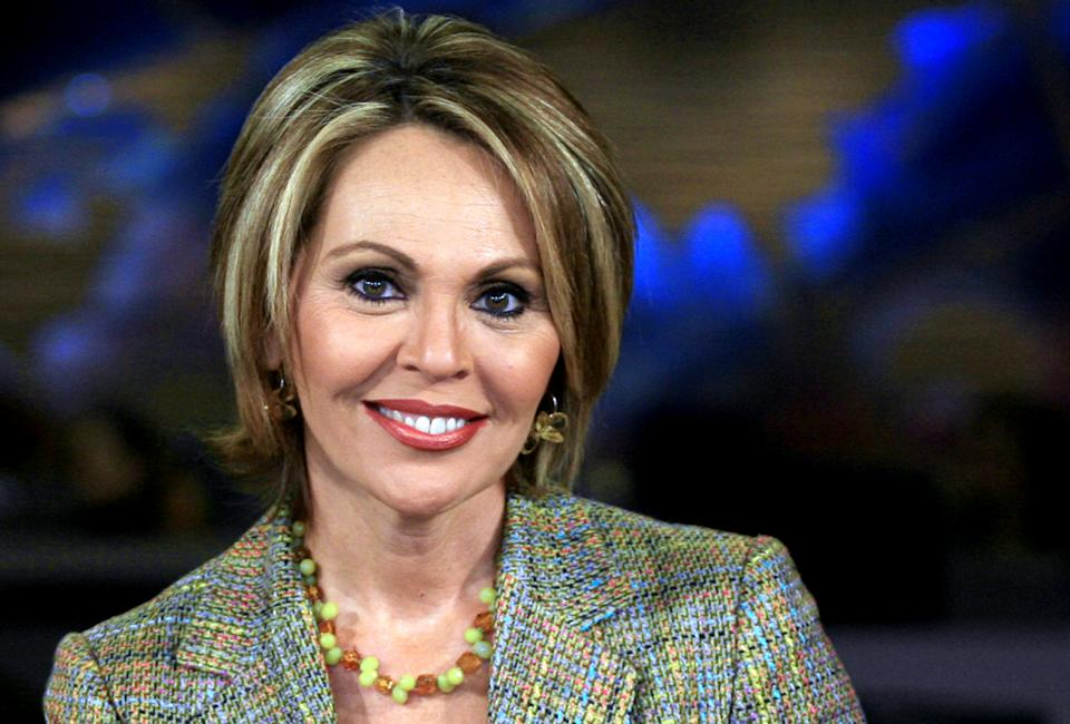 "FILE - In this March 31, 2006 file photo, Maria Elena Salinas poses at the Univision studio in Miami. Just a month after Forbes Magazine recognized the Hispanic television market as ""the next media jackpot,"" some are complaining that Hispanic media aren't getting a fair share of attention from the political realm. (AP Photo/Luis M. Alvarez, File)"