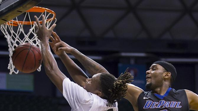 DePaul center Tommy Hamilton IV (2) blocks the shot of Colorado guard Xavier Johnson (2) in the first half of an NCAA college basketball game at the Diamond Head Classic on Monday, Dec. 22, 2014, in Honolulu.  (AP Photo/Eugene Tanner)
